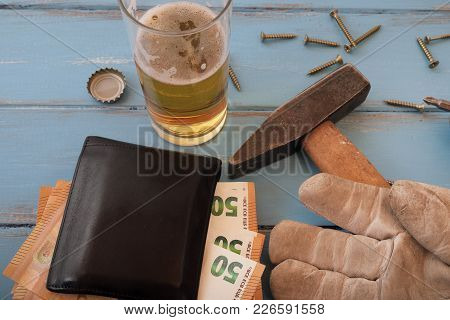 Handyman Tools On Blue Painted Boards With A Glass Of Beer And 50 Euro Bills