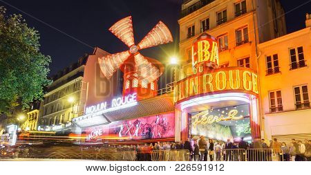 Paris - May 15: The Moulin Rouge Blurred Motion By Night, On May 15, 2015 In Paris, France. Moulin R