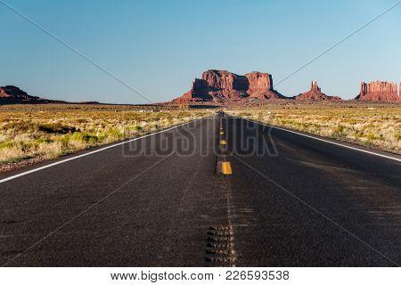 Empty scenic highway in Monument Valley, Arizona, USA