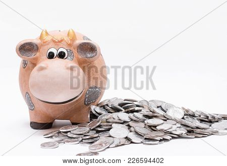 Piggy Bank And Coins Over White Background.