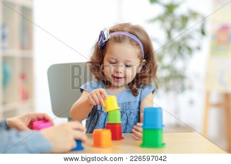Kid Playing Developmental Toys At Home Or Kindergarten