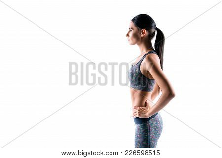Side Profile Half-faced Portrait Of Focused Sexy Slim Young Sportswoman Wearing Fashionable Comforta