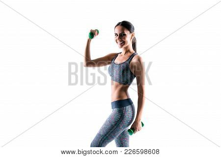 Attractive Beautiful Sporty Healthy Woman Wearing Tight Clothes Is Doing Exercises Using Dumbbells,