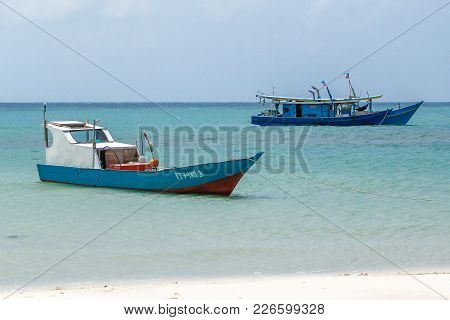 Kudat,sabah-feb 3,2018:fishing Boats In Sandy Tropical Beach In Kulambu,kudat,sabah.it Is A Sand Bar