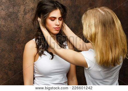 Photo Of Brunette Model And Stylist On Brown Wall Background In Studio