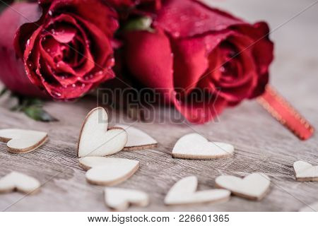 Roses And A Hearts Shape On Wooden Table Background , Love, Wedding And Valentines Day Concept.