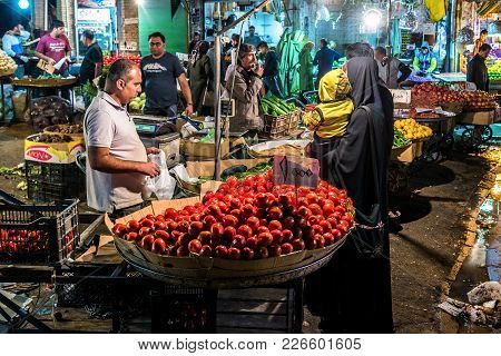 Shiraz, Iran - October 22, 2016: Iranian Woman Buys Vegetables A Food Market In Shiraz City
