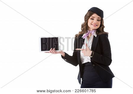 Attractive Stewardess Pointing On Tablet With Blank Screen Isolated On White
