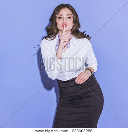 Attractive Stewardess Showing Silence Sign On Purple