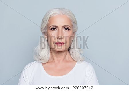 Portrait  Of Nice, Charming, Aged, Concentrated, Woman With Serious Expression, Standing Over Gray B