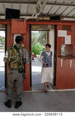 HEBRON, ISRAEL - AUGUST 04, 2010:  Vertical picture of jew woman at the check point to get in to the