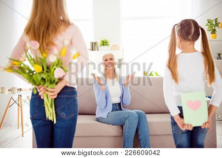 International Woman's Day Comfort Concept. Mum Hiding Tulips Behind Back Kid Card With Heat For Asto