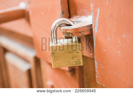 Close-up Padlock On The Door For Wooden Door Lock At Home