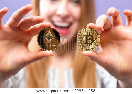 Woman Holding Physical Bitcoin And Ethereum Cryptocurrency Coins In Her Hands