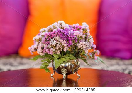 The Violet Or Pink Flowers In Vast On The Grass Table With Pillows In The Living Room , Vintage Styl
