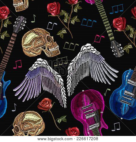 Embroidery Rock Music Seamless Pattern. Guitar, Gothic Roses, Angel Wings, Human Skull, Music Notes.