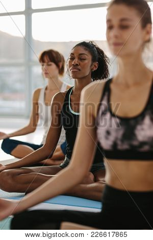 Mindfulness And Peaceful Yoga Meditation In Gym