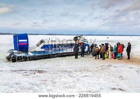 Samara, Russia - February 03, 2018: Embarkation People On The Passenger Neptune Hovercraft At The Ic