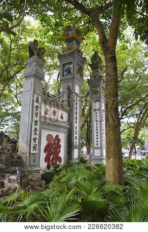 A Temple Gate By Hoan Kiem Lake In Hanoi, Vietnam