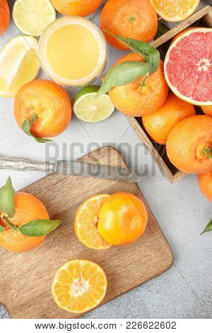 Citrus Background. Colorful Fresh Citrus Fruit On Table With A Knife. Tangerine, Lime, Lemon, Grapef