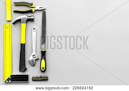 Repair Tools. Hummer, Corner Ruler On Grey Background Top View Copy Space Pattern.