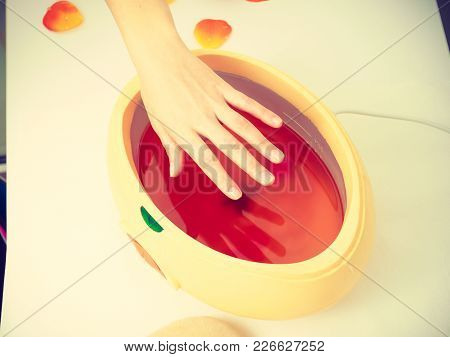 Handcare, Beauty Studio Wellness Treatments Concept. Woman Getting Paraffin Hand Treatment At Spa Sa