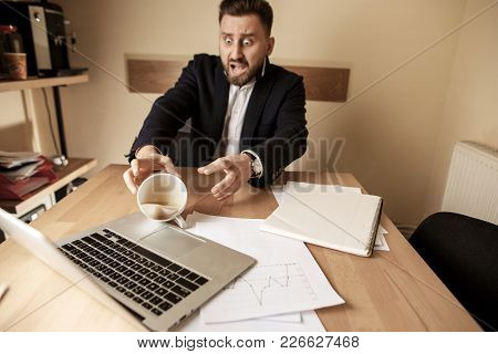 The Male Hands And Coffee In White Cup Spilling In Slow Motion Or Movement On The Table With Laptop