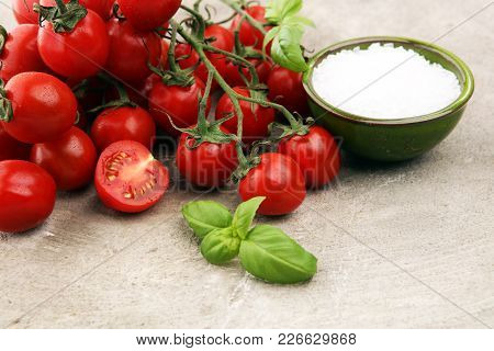 Ripe Tasty Red Tomatoes With Salt And Basil. Village Market Organic Tomatoes. Fresh Tomato