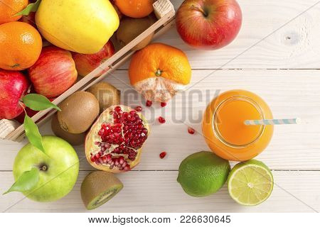 Juice And Fruits On Background Top View. Healthy Lifestyle. A Glass Of Freshly Squeezed Juice On The