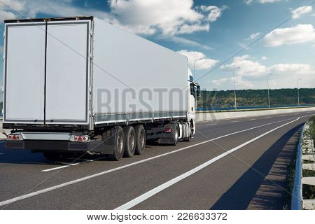 one truck with container on road, cargo transportation and shipping concept