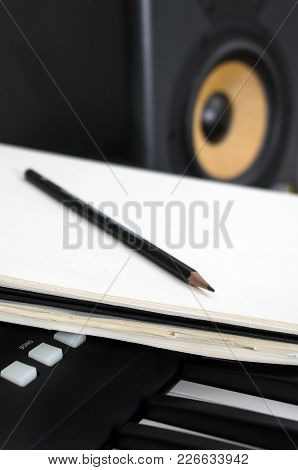 Piano Keyboard, Pen And Sheet. Concept Of Composing Song.