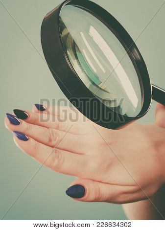 Gel Hybrid Manicure Concept. Blonde Woman Looking At Her Blue Painted Long Beautiful Nails.