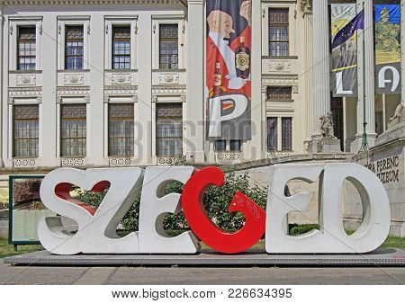 Szeged, Hungary - July 11, 2017: City Sign Of Szeged In Front Of Building Of Ferenc Mora Museum