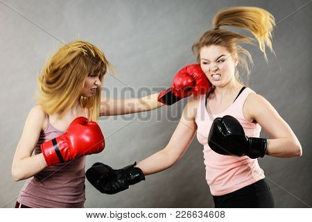 Two Agressive Women Wearing Boxing Gloves Having Argue Fight Being Mad At Each Other. Female Violanc