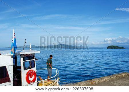 Taveuni, Fiji - November 29: National Flag Of Fiji Flying On A Small Boat Docked At Korean Wharf On