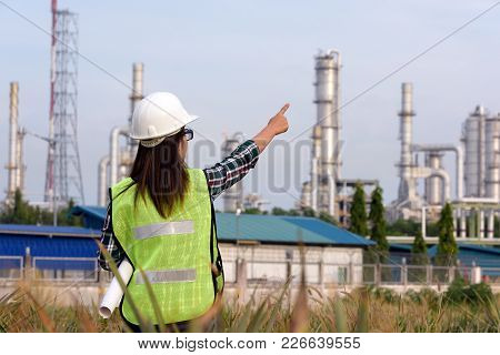Double Exposure Of Female Site Engineer With Hardhat And Safety Jacket Writing  Message Occupational