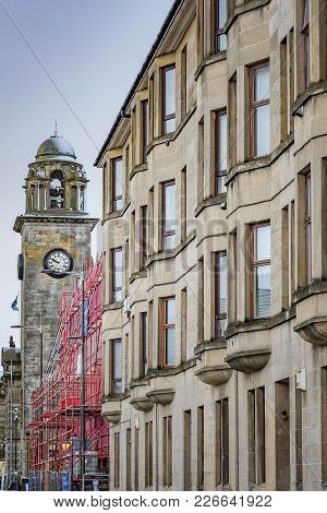 A View Of The Town Hall Clock Tower In Clydebank Next To A Nearby Tenement.