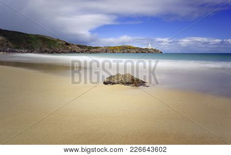 A Beach View Of Fanad Head Lighthouse In Donegal.
