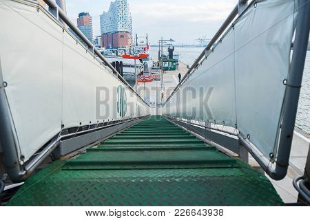Hamburg, Germany - January 2018. The Gangway Of The Ship With A Green Path Is A View From Above With
