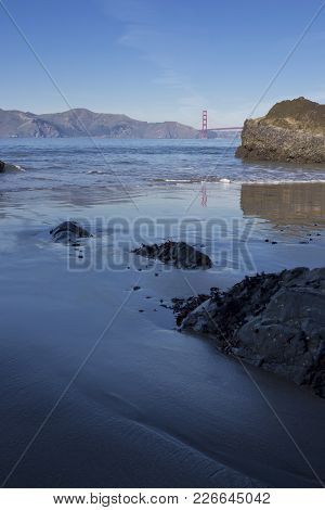 China Beach Shoreline With The Golden Gate Bridge In The Background.