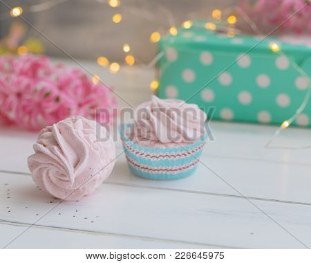 Russian Zephyr Or Pink Marshmallow On The White Background. Spring Postcard Concept