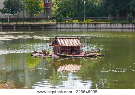 Duck House On The Poplavok Pond. Kaliningrad, Russia.