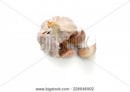 Extreme close-up image of garlic studio isolated on white background, view above
