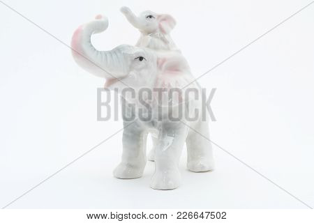 Porcelain Elephants. Isolated On White Background For Any Purpose