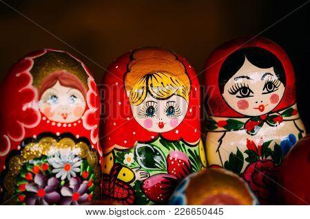 Colorful Russian Nesting Dolls Matreshka At Market. Matrioshka Babushka Are Most Popular Souvenir Fr