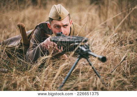 Pribor, Belarus - April, 04, 2015: Unidentified Re-enactor Dressed As Soviet Russian Soldier Aiming