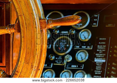 Yellow, Old, Lacquered, Wooden Steering Wheel On A Marine Yacht, Control Devices, Sensors, Buttons A