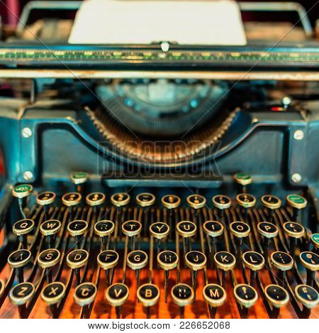 Antique, Metal, Typewriter With A Sheet Of White Paper And Keys Of Letters And Numbers