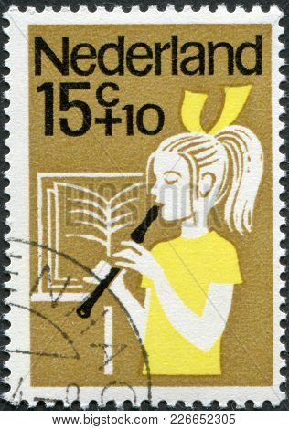 Netherlands - Circa 1964: A Stamp Printed In The Netherlands, Shows A Girl Playing The Flute, Circa