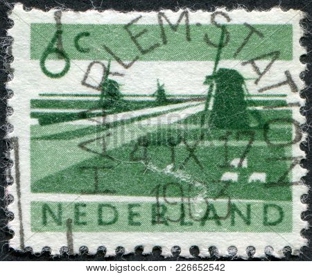 Netherlands - Circa 1962: A Stamp Printed In The Netherlands, Shows Polder With Canals And Windmills
